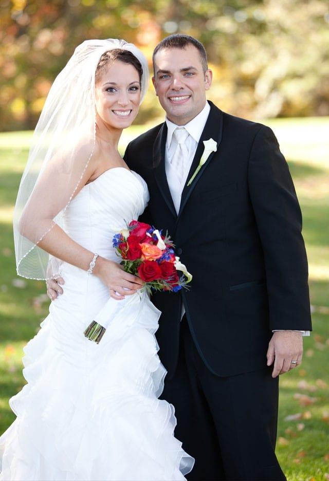 Maggie Bride, Gina, wearing an organza A-line wedding dress.