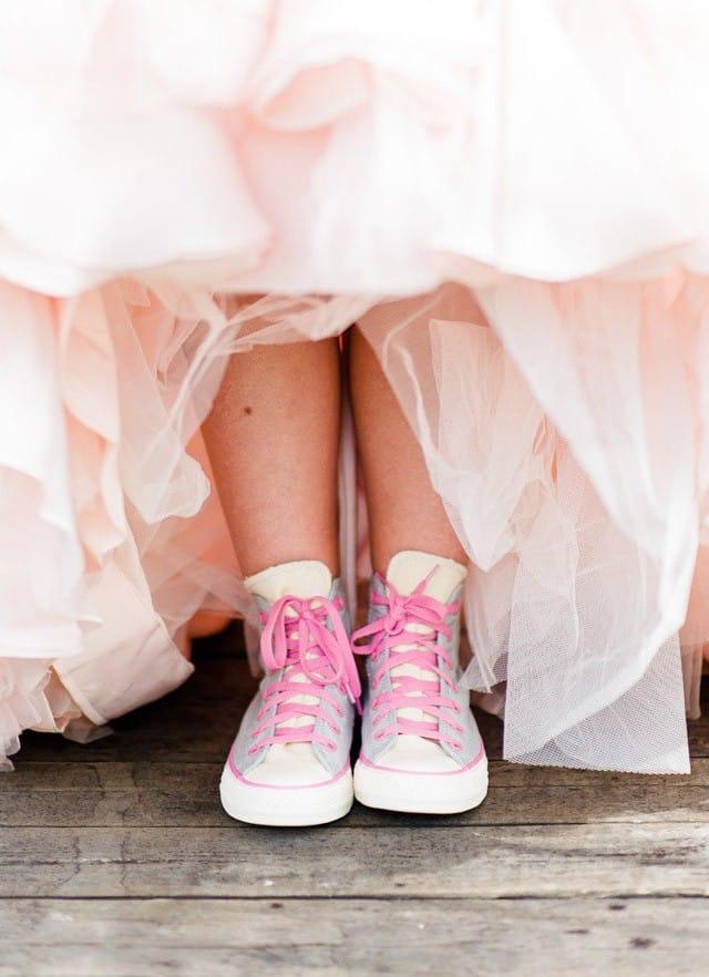 Maggie Bride wearing blush Divina wedding dress