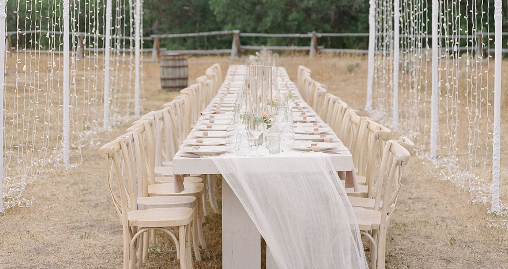 Outdoor Wedding Table Setting Under Fairy Lights