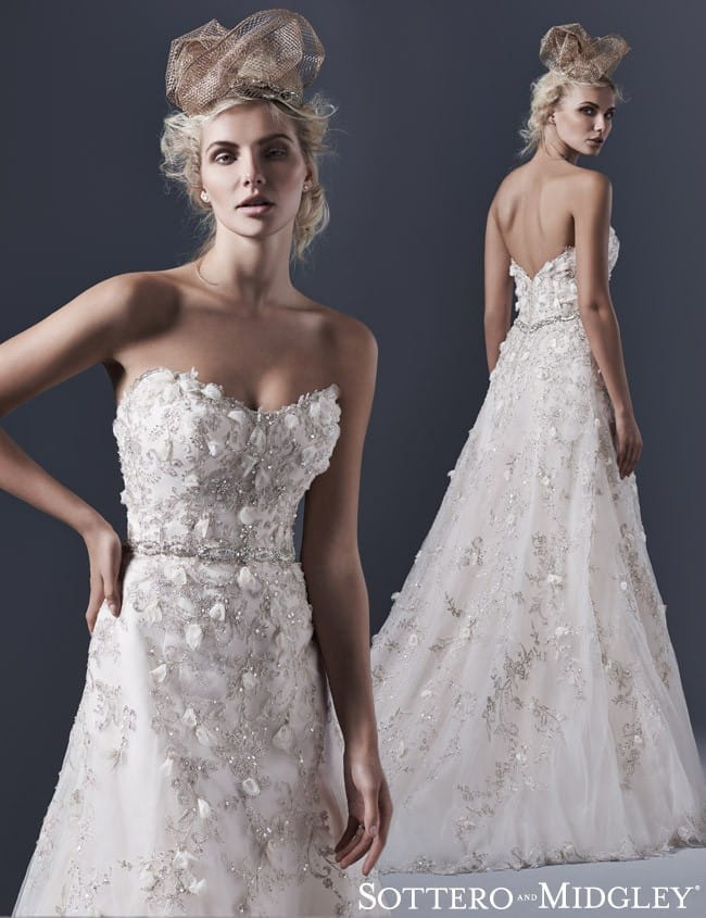 Floral embellishments on a dramatic A-line wedding dress by Sottero and Midgley